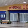 Staff photo by Mike Elswick<br />    The front of Cinema 10 at Arrowhead Mall was barren of all movie posters while the gate was closed permanently as contract workers were busy inside Tuesday gutting equipment, fixtures and seating from the theater, which closed Monday.