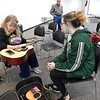 KENTON BROOKS/Muskogee Phoenix<br /> Selby Minner, left, tunes Hadleigh Smith's guitar prior to giving her and others lessons at the Dr. Martin Luther King Jr. Community Center. Taylor Blake, right, and A.C. Lorenz listen. Minner has been teaching guitar for 14 years.