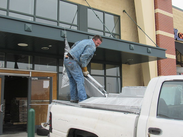 CATHY SPAULDING/Muskogee Phoenix<br /> Ronnie Norton removes shelves from the former Dick's Sporting Goods on Wednesday. Hibbett Sports is set to open Jan. 26 at Three Rivers Plaza in the location. Dick's closed its Muskogee location in January 2018.