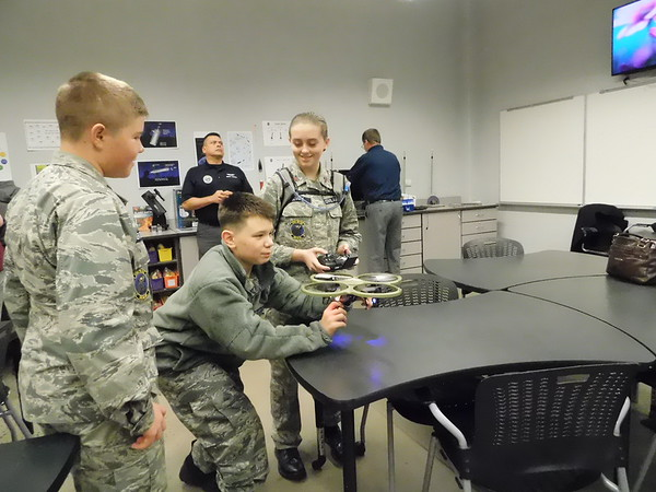 KENTON BROOKS/Muskogee Phoenix<br /> Senior airman Logan Hofer of the Civilian Air Patrol, holds a drone while fellow members Caleb Brown and Angelena Sowell watch during the Muskogee STEAM Center demonstration on Thursday. The program was open to the public and featured demonstrations ranging from virtual reality, robotics and using caution around high voltage. The STEAM (Science, Technology, Engineering, Arts and Math) Center had demonstrations in nine different fields at the New Tech building at the Alice Robertson Junior High School campus. The demonstrations ranged from virtual reality to robotics to care around high voltage. A similar event, Tinkerfest, is scheduled for Feb. 29.