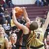 JOHN HASLER/Phoenix Special Photo<br /> Okay's Kinlea Green attempts a shot against Warner's Emma Sikes in Thursday's game at Warner.