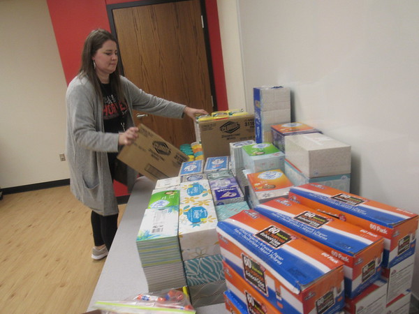 CATHY SPAULDING/Muskogee Phoenix<br /> Hilldale Elementary Parent Teacher Organization President Kawana Dick stocks a table with items collected during this week's School Supply War.