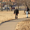 Staff photo by Cathy Spaulding<br /> After a morning low of 2 degrees, temperatures rose to 31 degrees and brought a trickle of people outside Wednesday afternoon. Deborah and Tom Carment have Civitan Park to themselves Wednesday as they enjoy a brisk afternoon walk.