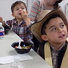 Staff photo by Mike Elswick<br /> Liam Flores, 2, and Domani Flores, 6, got to sample stone soup they and other youngsters helped make at the Muskogee Public Library during a cooking lesson held Wednesday as part the library's WOW Wednesday program.