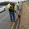 CATHY SPAULDING/Muskogee Phoenix<br /> Muskogee workers Stormie Rice, left, and Roy Smith scrape dirt off the curb of the Main Street median. Crews worked on the median's northbound side on Thursday afternoon.