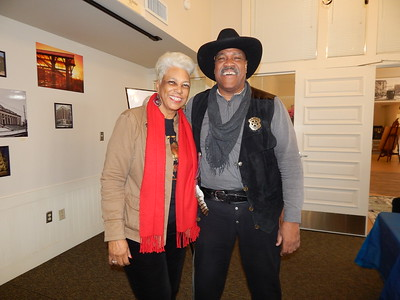 KENTON BROOKS/Muskogee Phoenix ShIronbutterfly Ray and her husband, Oscar Dean Ray, share a laugh at Three Rivers Museum. Oscar was dressed as Bass Reeves, a former marshal in Muskogee, at the Muskogee County Historical Society. The couple will be the grand marshals in the Martin Luther King Jr. Day Parade on Monday.