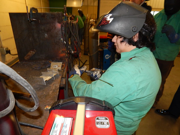 CATHY SPAULDING/Muskogee Phoenix<br /> Muskogee High School junior Jaiden Carter sets up his TIG welding torch. The school bought two TIG welding units with an Education Foundation of Muskogee grant.