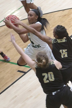 JOHN HASLER/Phoenix Special Photo<br /> Tea Myers drives to the bakset against a pair of Broken Arrow defenders Friday night at Ron Milam Gymasium. Myers and the Lady Roughers led at the half but lost 64-54.