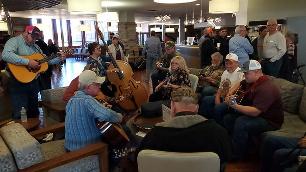 CHESLEY OXENDINE/Muskogee Phoenix<br /> Groups of musicians gathered Saturday throughout Sequoyah Lodge for the 41st annual Western Hills Bluegrass Festival. Often, new musicians would wander by and join in impromptu jam sessions like this one.