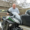 CATHY SPAULDING/Muskogee Phoenix<br /> Roy Thornburg rolls his Kawasaki into a Muskogee Animal Shelter parking spot. He said he can go fast on the cycle, but prefers cruising.