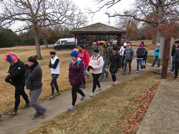 CATHY SPAULDING/Muskogee Phoenix<br /> Hikers set out on the First Day Hike, held Tuesday at Greenleaf State Park. Many hikers tried a four-mile trek, while some referred the mile walk on paved paths.