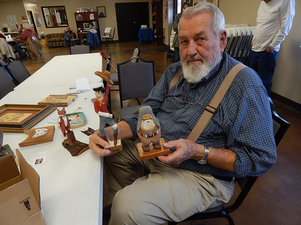 KENTON BROOKS/Muskogee Phoenix<br /> Gale Hill of Muskogee show some of his work he's whittled as a member of the Okie Whittlers Club. The 83-year-old Hill has been whittling (wood carving) for 11 years.