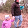 CATHY SPAULDING/Muskogee Phoenix<br /> Daniel Griffiths walks his 2-year-old daughter, Iris Griffiths, along the Greenleaf State Park's paved trail on Tuesday. The walk was part of the Oklahoma State Parks' First Day Hikes program.