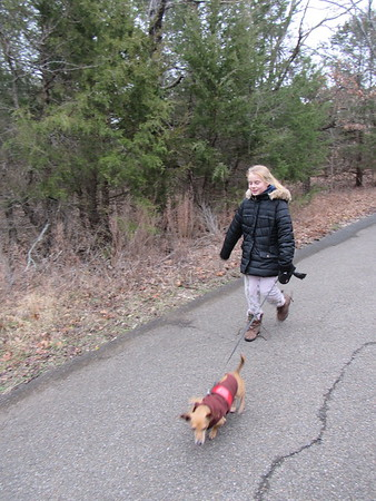 CATHY SPAULDING/Muskogee Phoenix Sophia Griffiths, 6, walks Odie, the family dog, along Greenleaf State Park's paved Family Fun Trail during the First Day Hike.