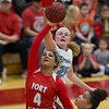 Phoenix special photo by Von Castor<br /> Fort Gibson's Alexis Wright shoots as Bartlesville's Jena' Williams tries to block Friday night in the girls semifinal of the Old Fort Classic at Fort Gibson.
