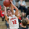 Phoenix special photo by Von Castor<br /> Fort Gibson's Carson Calavan shoots and is fouled from behind by Inola's Jayden Biggs on Saturday in the boys championship game of the Old Fort Classic at Harrison Field House. The Tigers beat the Longhorns 67-56 to win the title.