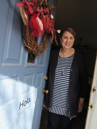 """Staff photo by Cathy Spaulding<br /> Nancy McLemore shares her Spanish version of """"hello"""" on her front door."""