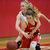 Phoenix special photo by Von Castor<br /> Fort Gibson's Zoey Whiteley is fouled by Harrah's Erika Ankney after a rebound late in the fourth quarter on Saturday in the third-place game of the Old Fort Classic at Harrison Field House. The Class 4A No. 2 Lady Tigers knocked off No. 1 Harrah 54-50.