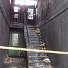 Staff photo by Mike Elswick<br /> Long after Muskogee Fire Department crews had cleared the scene of a fire at Village East Apartments, city  public works crews were called in to shut off water flowing down the stairs from upstairs units. Six families were reportedly left homeless from the blaze.