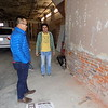 Staff photo by Mike Elswick<br /> Phan Nguyen, left, visits with a worker at the Main Street commercial structures he and wife Jessica Nguyen purchased and renovating.