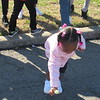 CATHY SPAULDING/Muskogee Phoenix<br /> Ryann Smith, 2, picks up a lollipop from Martin Luther King Street during Monday's Martin Luther King Jr. Day parade.