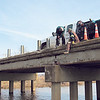 CATHY SPAULDING/Muskogee Phoenix<br /> Workers with the Fort Gibson Utilities Authority drill into concrete while installing guardrail braces on a bridge south of Fort Gibson. Fort Gibson Public Works Director Jason Million said a driver hit a guardrail on U.S. 62 Business route several weeks ago. The bridge crossed the headwaters of Ross Lake.
