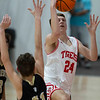 VON CASTOR/Phoenix Special Photo<br /> Fort Gibson's Conner Calavan drives the lane to score two of his career-high 41 points, shooting over McAlester's Billy Cornish Tuesday night at Fort Gibson.