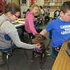 Staff photo by Cathy Spaulding<br /> Fifth-graders, from left, Abigail Kelly, Shyann Gray and Tatcher Wilson pet Bella, a therapy dog, on her first week of duty at Intermediate Elementary School.