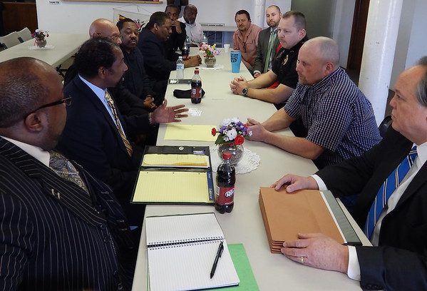Staff photo by D.E. Smoot<br /> NAACP Oklahoma Charter President Anthony R. Douglas, second from left, leads the discussion Tuesday with Warner officials during a meeting requested after two former Warner employees made racially charged comments about Martin Luther King Jr. Day.