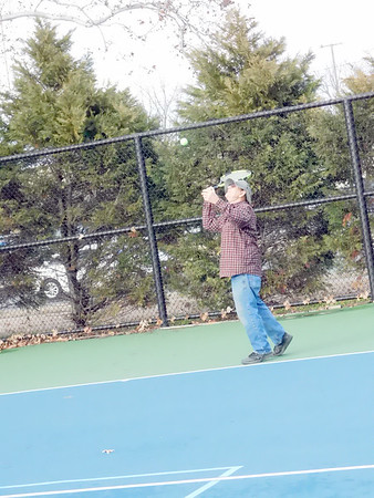 """KENTON BROOKS/Muskogee Phoenix<br /> John Martin, 71, of Muskogee didn't let the cold weather keep him off the courts to play a little tennis at Spaulding Park. """"The weather is a little bit better than normal, so we decided to come out for a while,"""" the retiree said."""