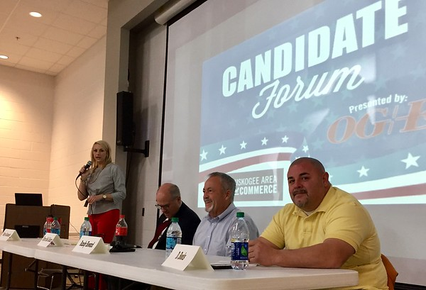 Staff photo by D.E. Smoot<br /> D.J. Thompson, left, president and chief executive officer of the Greater Muskogee Area Chamber of Commerce, introduces those who participated Thursday morning in a forum for city council candidates. Participating candidates included, from left, Mayor Bob Coburn and Ward III candidates Randy Howard and D. Boots.