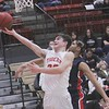 JOHN HASLER/Phoenix Special Photo<br /> Fort Gibson's Jaxon Blunt goes for a layup while defended by Tulsa Hale's Demetrius Cain in action Thursday in the Old Fort Classic basketball tournament. The Tigers won 88-46.