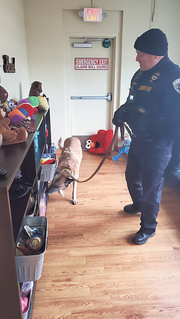 CHESLEY OXENDINE/Muskogee Phoenix<br /> Deputy Bryan Jones leads Muskogee County Sheriff's Office K-9 officer Tibo through the women's lounge at the Gospel Rescue Mission during a random search.