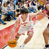 CHRIS CUMMINGS/Special to the Phoenix<br /> Fort Gibson's Jaxon Blunt, left, dribbles around Oklahoma Union's Jace Hollingshed toward the basket during Friday's second boys semifinal of the Old Fort Classic in Fort Gibson. The Tigers won 76-74.