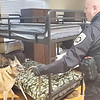 CHESLEY OXENDINE/Muskogee Phoenix<br /> Deputy Bryan Jones leads Muskogee County Sheriff's Office K-9 officer Tibo through the men's dorm at the Gospel Rescue Mission during a random search.