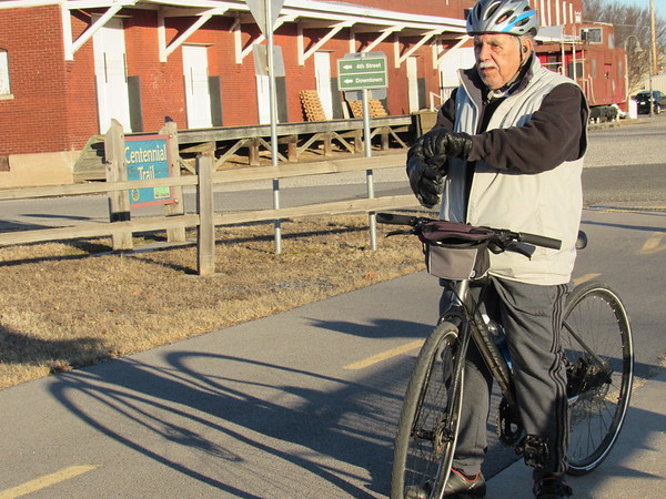 Staff photo by Cathy Spaulding<br /> Jerry Carlton pauses near the Oklahoma Music Hall of Fame as he prepares to bicycle along Centennial Trail. He said he rides the trail every day.