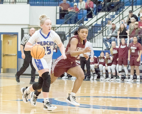 ABIGAIL WASHINGTON/Special to the Phoenix<br /> Checotah's Emma Waller, left, pushes the ball up the floor by Eufaula's Desirae Evans during Saturday's girls championship game of the Checotah Crossroads Classic.
