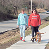 CATHY SPAULDING/Muskogee Phoenix<br /> Stevie Levesque, left, and Brittany Ledford take Diamond for a walk on a new sidewalk along West Shawnee Street. The side walk is funded mostly by a grant from the Tobacco Settlement Endowment Trust.