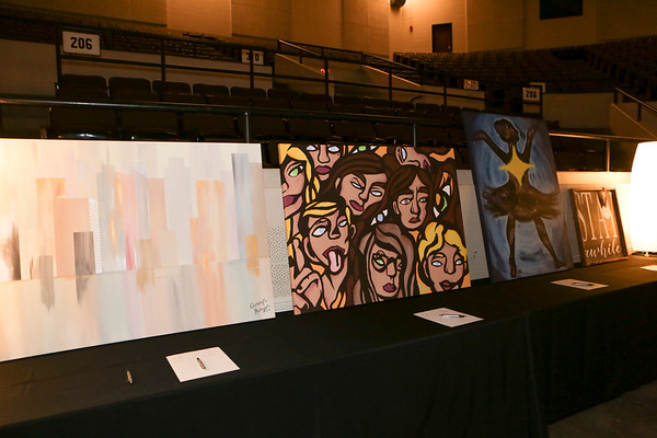 Special photo by Mandy Lynn Corbell<br /> Student artworks were among the items offered to the highest bidder as part of a fundraiser held Friday night at the Muskogee Civic Center for the Muskogee Education Foundation.
