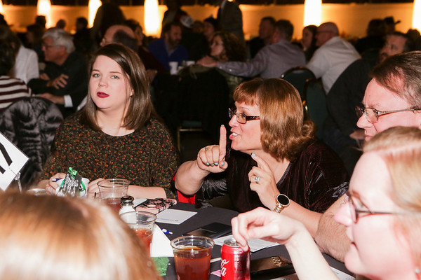 Special photo by Mandy Lynn Corbell<br /> Muskogee Creek Elementary teachers Shelbi Taylor, left, and Angela Cummings, center, were among about 350 attendees at Friday's Trivia Challenge 2018 fundraiser for the Muskogee Education Foundation.
