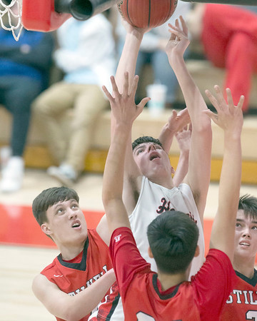 VON CASTOR/Special to the Phoenix<br /> Hilldale's Ty O'Neal shoots from under the basket that is guarded heavily by three Stilwell defenders Saturday night in the finals of the Old Fort Classic in Fort Gibson.