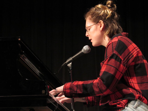 """CATHY SPAULDING/Muskogee Phoenix<br /> Madison Smith accompanies herself and sings """"Like This"""" during a Friday talent show at Fort Gibson High School."""