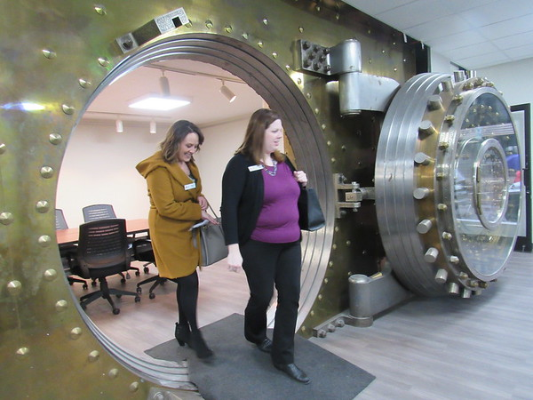 CATHY SPAULDING/Muskogee Phoenix<br /> Meagan Farley, left, and Liz Rohrbacker, both of KKT Architects, step out of a Muskogee Public Schools conference room located in a former bank vault at the MPS Education Service Center. Dozens toured the refurbished center during a ribbon cutting and open house on Tuesday. MPS has had its central offices at the former First National Bank building, 202 W. Broadway, since the mid-1990s. In 2018 and 2019, the building underwent a $2 million renovation. School offices moved temporarily to the former Harris-Jobe Elementary School, returning downtown last December. The Education Service Center houses district administration, finance, human resources, curriculum, the board of education meeting room and an enrollment center.