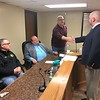CHESLEY OXENDINE/Muskogee Phoenix<br /> From left to right: County Sheriff Rob Frazier, District 2 Commissioner Stephen Wright, and County Treasurer Kelly Garrett congratulate District 3 Commissioner Kenny Payne, who ran unopposed to remain in his position, on his swearing in.