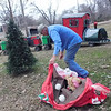KENTON BROOKS/Muskogee Phoenix<br /> Jerry Wachob of Muskogee starts to take down one of the 120 Christmas inflatables he has in his mother's yard on the east side of Muskogee. Wachob said he's been putting up the inflatables for 15 years, and he starts in the end of October so he can have them up by Thanksgiving.