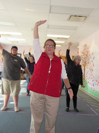 Staff photo by Cathy Spaulding<br /> Instructor Devon Murray, center, leads students, from left, Alex Hinkle, Mary Walters and Peggy Langston, right, in a tai chi move.