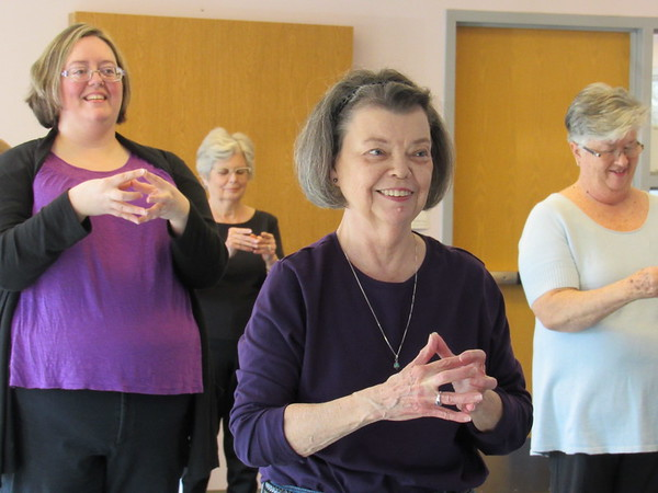 Staff photo by Cathy Spaulding<br /> Mary Walters, center, twiddles her fingers during a tai chi class at Q.B. Boydstun Library. She said she has noticed better balance since learning tai chi.