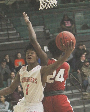 JOHN HASLER/Muskogee Phoenix<br /> Muskogee's De'Andre Titsworth lays in score the under arm of Owasso's Kyler Mann during Tuesday's game at Ron Milam Gymnasium.