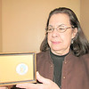 CATHY SPAULDING/Muskogee Phoenix<br /> Artist-turned opera singer Barbara McAlister shows a miniature portrait of early Cherokee linguist Sequoyah. It is one of many of her works to be displayed through February at Five Civilized Tribes Museum.