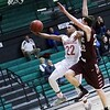 Phoenix special photo by John Hasler<br /> Muskogee's Xavier Brown lays a shot up in front of Jenks' Blake Seacat during the Roughers' 76-68 loss on Tuesday.